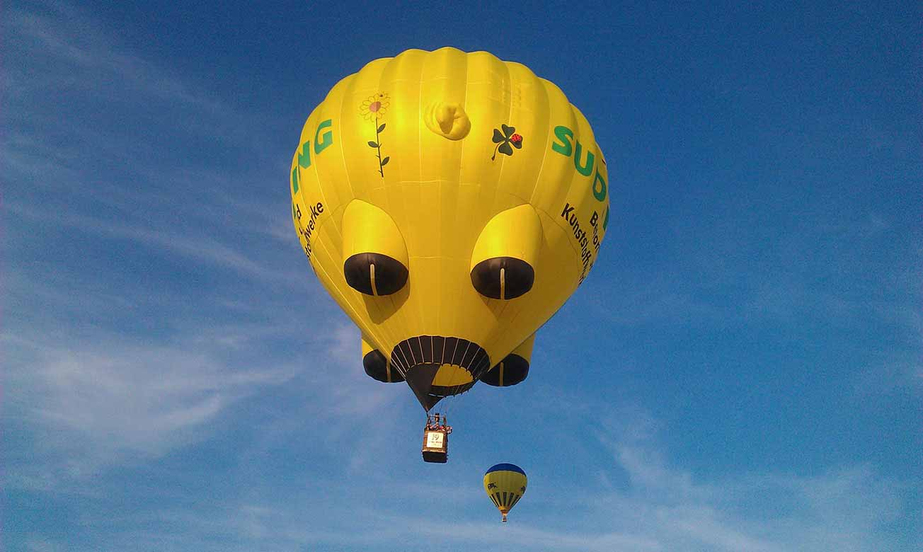 A yellow balloon - On a clear summer sky