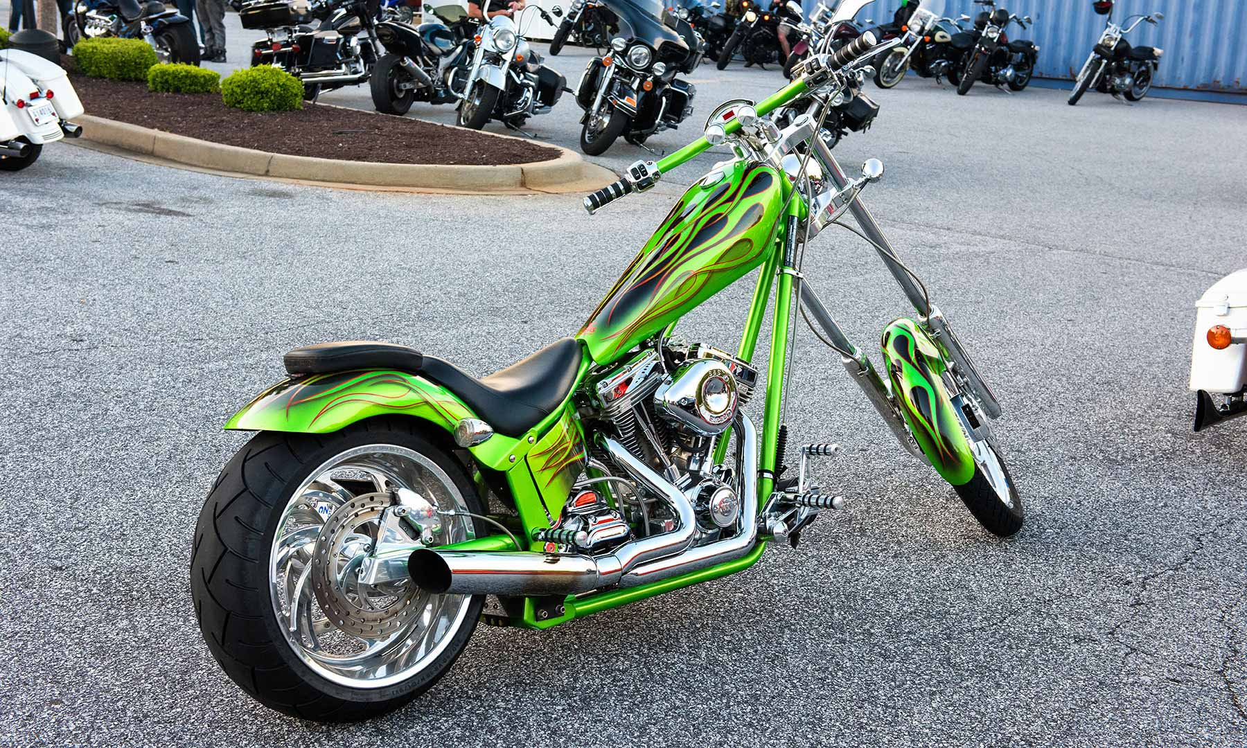 A green chopper - In a motorcycle parking